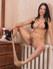 A day of mirror cleaning is over for Polina and she celebrates by stripping naked. She takes off the stockings and panties and climbs on the wooden dresser. She shows her hairy pussy and 34B breasts there.
