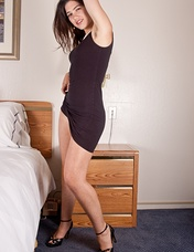 Just back to her room from being out with her friends she is anxious to get out of her beautiful black dress. As she strips, she love looking at her hairy underarms and playing with her hairy pussy!