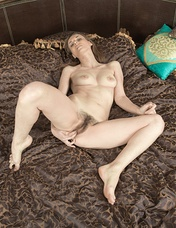 Donatella has a brown round bed, and loves to lay naked on it. She strips naked, and lays her hairy body across it. Her hairy pits and hairy pussy keep warm, and she models her natural body over it.