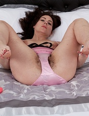 When hairy woman Sharlyn wants to relax, she loves wearing her pink and black lingerie and getting her pink dildo. She teases herself before stripping off her panties and masturbating her hairy pussy.